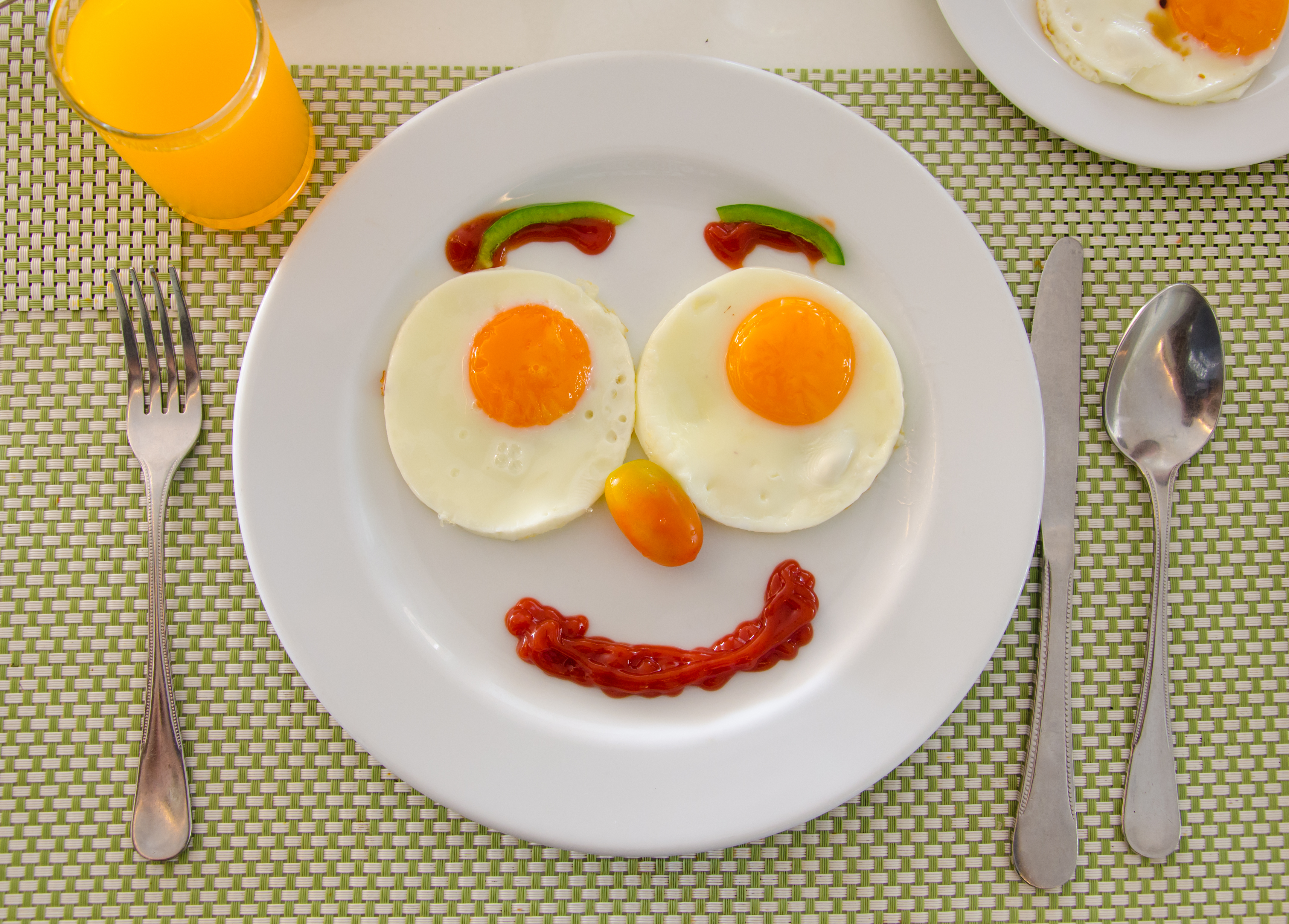 Smiley face made out of breakfast foods.