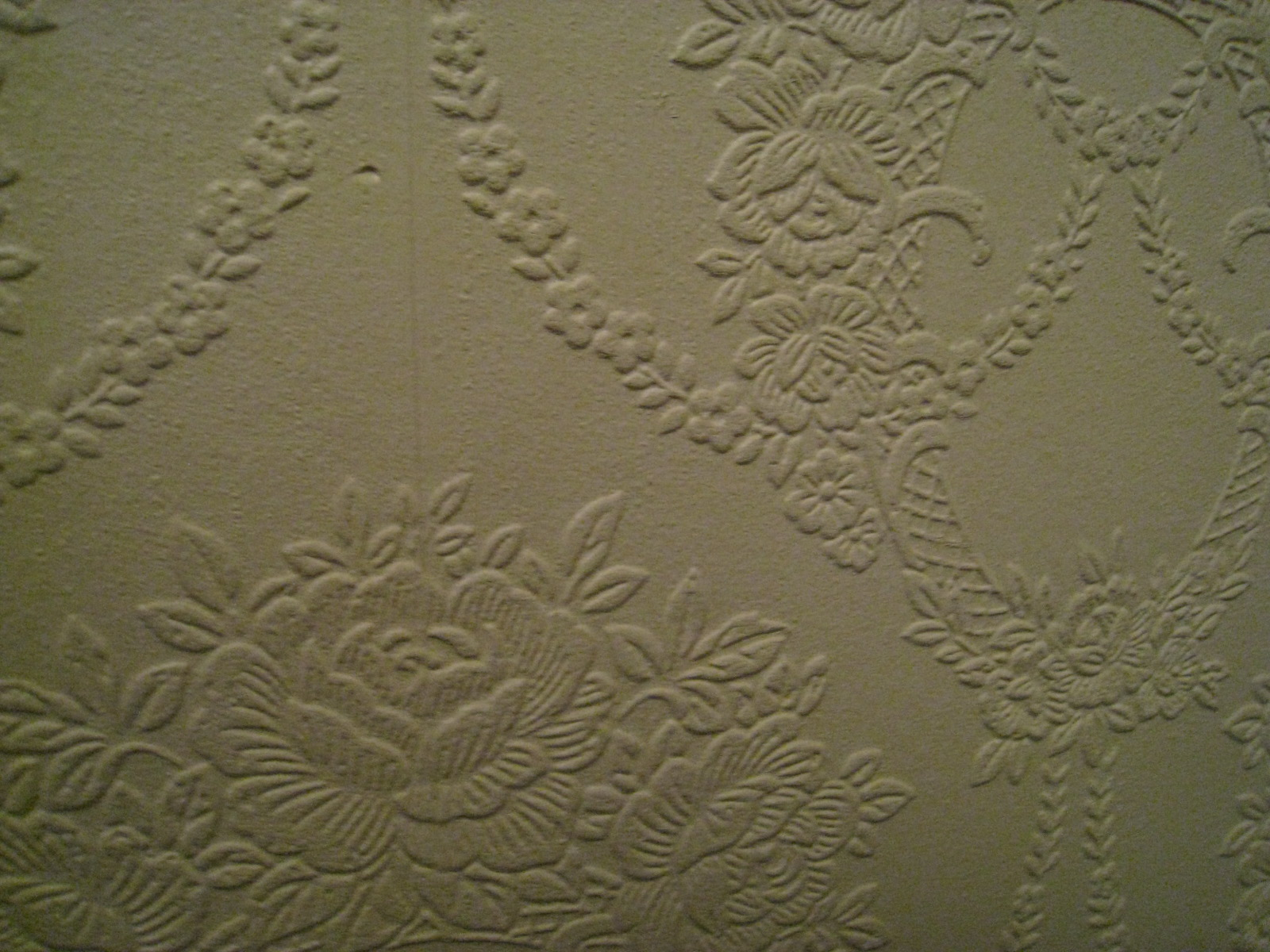 Covering textured wallpaper