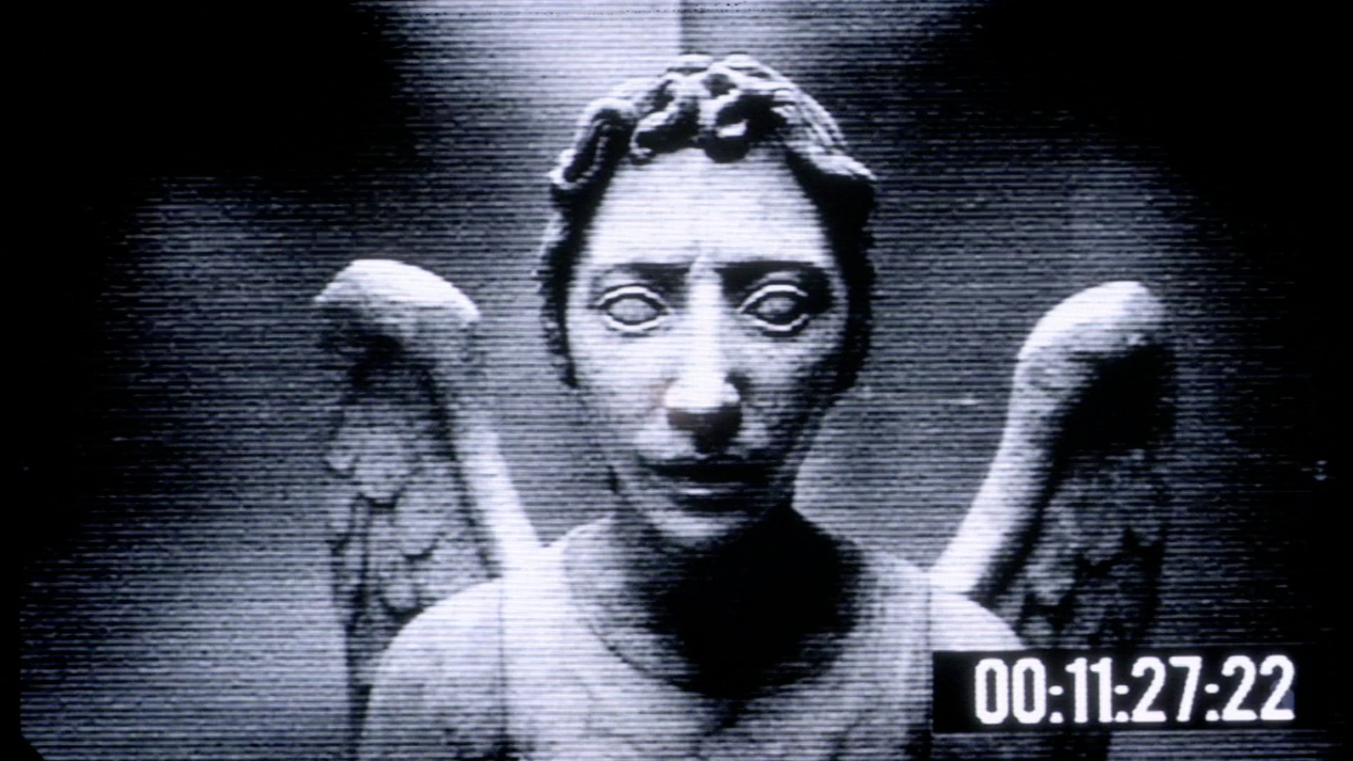 Creepy Angel Statue Wallpaper
